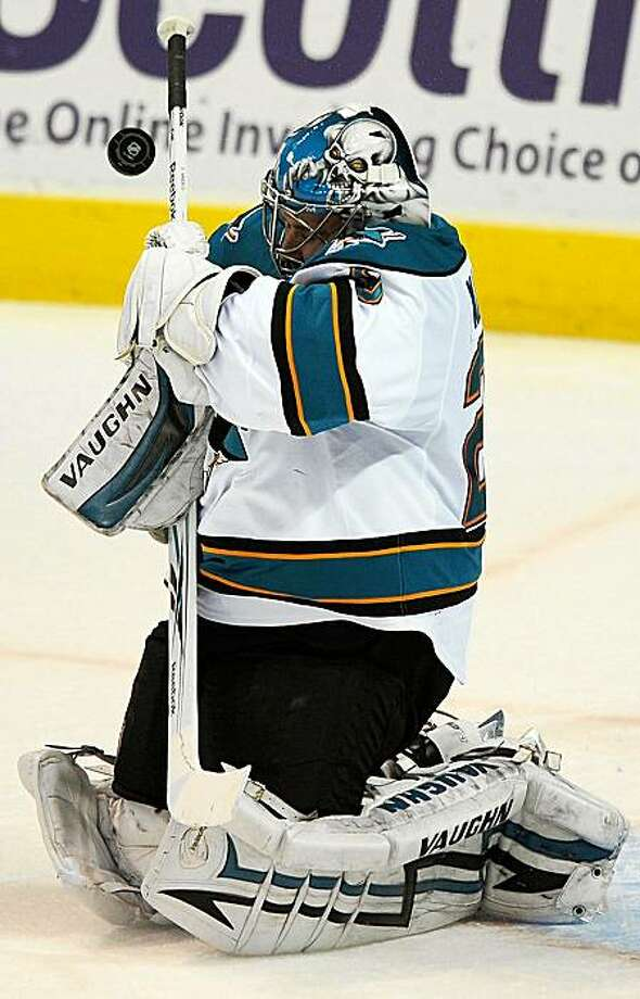 San Jose Sharks' Evgeni Nabokov blocks a shot by the St. Louis Blues in the second period of an NHL hockey game Saturday, Nov. 14, 2009 in St. Louis. The Sharks won 3-1. (AP Photo/Bill Boyce) Photo: Bill Boyce, AP