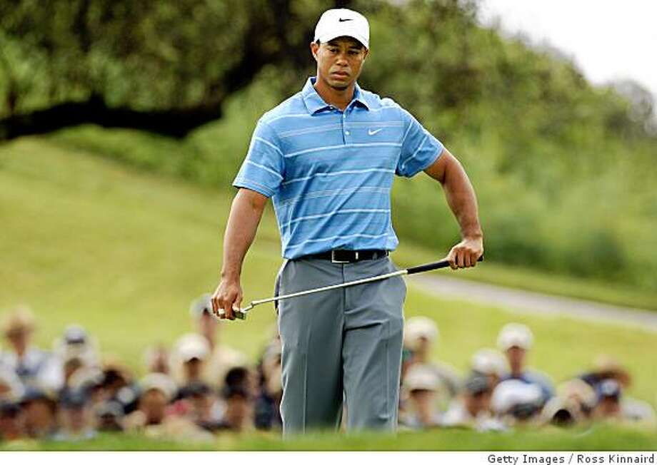 SAN DIEGO - JUNE 12:  Tiger Woods walks up the the 13th green during the first round of the 108th U.S. Open at the Torrey Pines Golf Course (South Course) on June 12, 2008 in San Diego, California.  (Photo by Ross Kinnaird/Getty Images) Photo: Getty Images