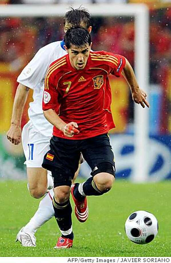 Spanish forward David Villa (front) runs past Russian midfielder Sergei Semak during their Euro 2008 Championships Group D football match Spain vs. Russia on June 10, 2008 at  Stade Tivoli Neu, in Innsbruck, Austria.  AFP PHOTO / JAVIER SORIANO   -- MOBILE SERVICES OUT --    (Photo credit should read JAVIER SORIANO/AFP/Getty Images) Photo: JAVIER SORIANO, AFP/Getty Images