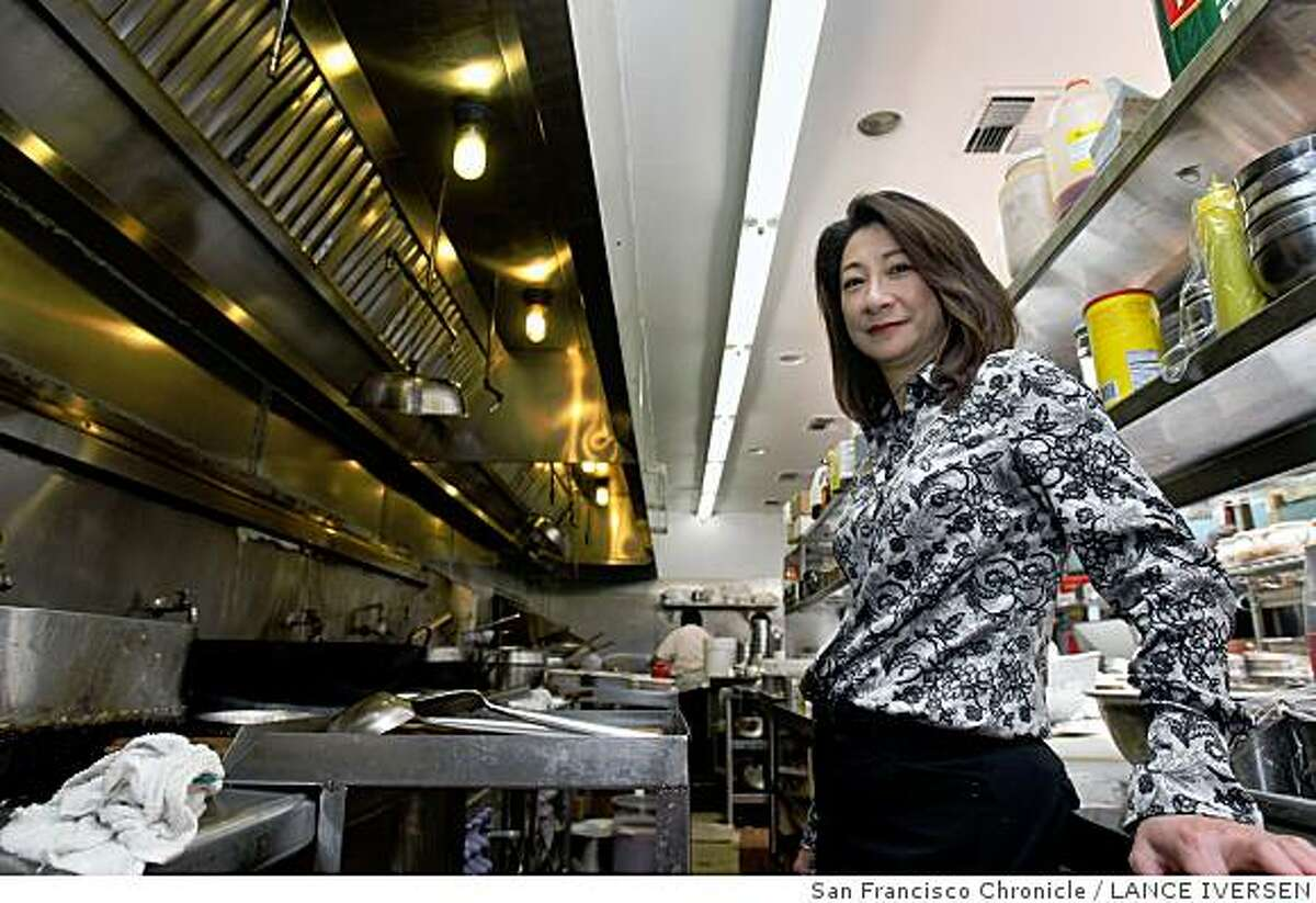 Environmentally friendly Tin�s Tea House, a dim sum restaurant in Walnut Creek. Has been going Green for years, Owner Alice Wan has been converting all the lights over to T-8 fluorescent light fixtures, installing them in both the kitchen and dinning room. Wan saves energy several way, besides the lights, she commutes to work daily with her brother and another co worker, she saves and stores used cooking oil for the emerging Bio-diesel market and uses bio degradable takeout containers made from corn or sugar cane. These containers don�t require any energy to break down once used simply toss into the compost pile. Photo taken Tuesday June 2, 2008 in Walnut Creek. By Lance Iversen / The Chronicle.