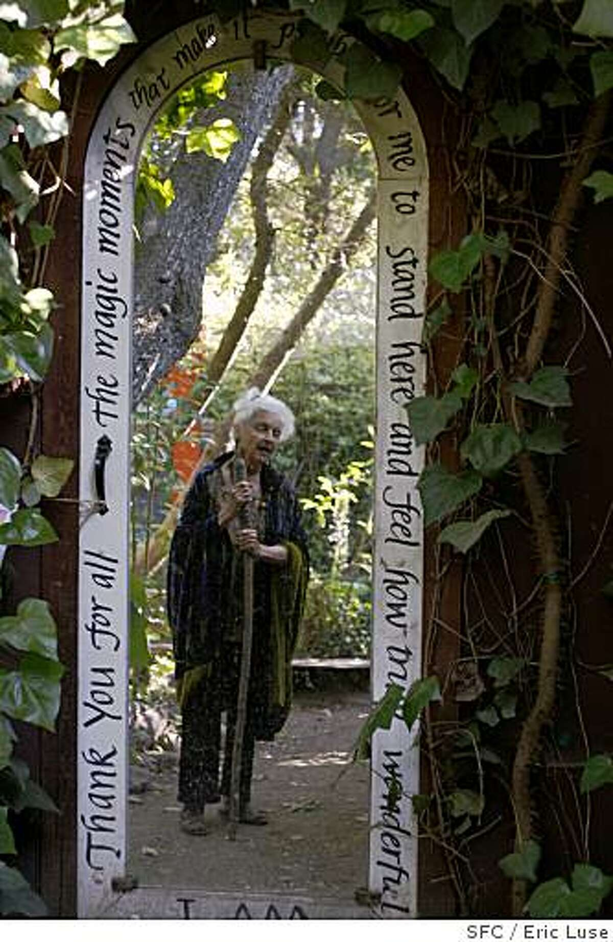 Betty Peck, reflected in a mirror in her garden. Chronicle photo by Eric Luse