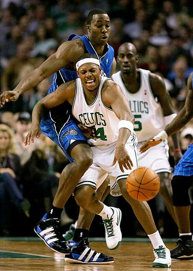 BOSTON - NOVEMBER 20: Paul Pierce #34 of the Boston Celtics tries to move the ball against the defense of Dwight Howard #12 of the Orlando Magic during the game on November 20, 2009 at the TD Garden in Boston, Massachusetts. NOTE TO USER: User expressly acknowledges and agrees that, by downloading and or using this photograph, User is consenting to the terms and conditions of the Getty Images License Agreement.  (Photo by Elsa/Getty Images) Photo: Elsa, Getty Images