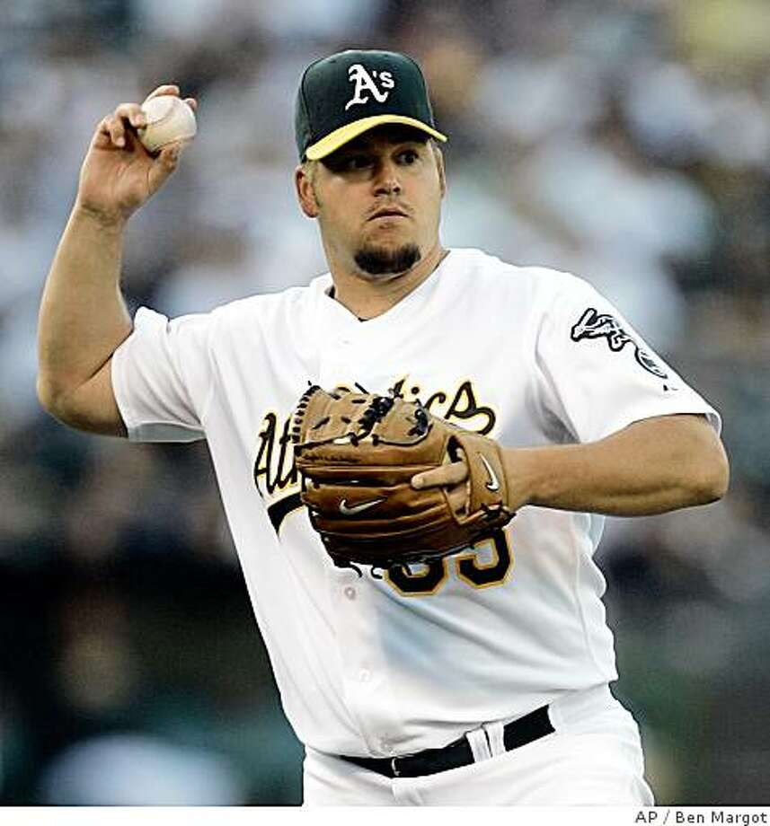 Oakland Athletics pitcher Joe Blanton throws to first base to make the out on New York Yankees' Derek Jeter in the first inning of a baseball game Thursday, June 12, 2008, in Oakland, Calif. (AP Photo/Ben Margot) Photo: Ben Margot, AP