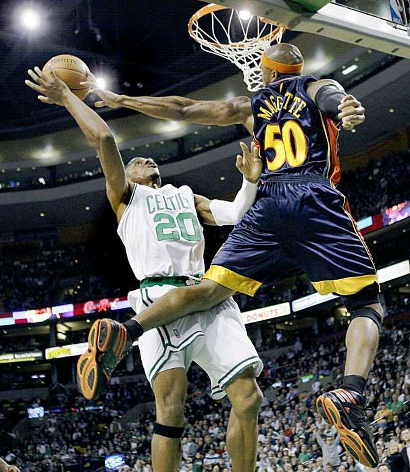 Golden State Warriors forward Corey Maggette (50) gets a hand on a shot by Boston Celtics guard Ray Allen during the second half of an NBA basketball game in Boston on Wednesday, Nov. 18, 2009. The Celtics won 109-95. (AP Photo/Elise Amendola) Photo: Elise Amendola, AP