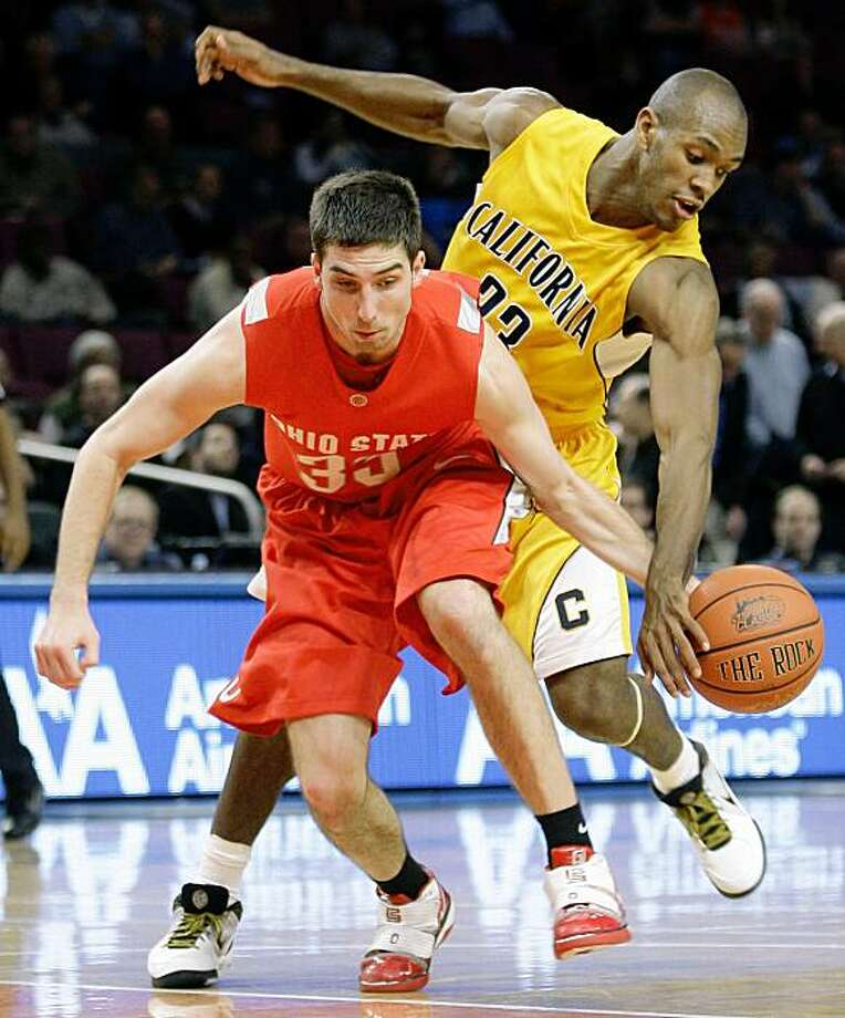 Ohio State's Jon Diebler, left, is fouled by California's Patrick Christopher during the second half of an NCAA college basketball game, Friday, Nov. 20, 2009, at Madison Square Garden in New York. Ohio State won 76-70. (AP Photo/Julie Jacobson) Photo: Julie Jacobson, AP
