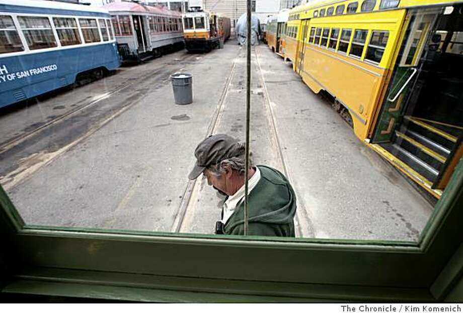 "Karl Johnson, Maintenance Supervisor of the San Francisco Municipal Railway's Geneva Car House in San Francisco, Calif., walks next to the ""Iron Monster,"" on June 3, 2008. The car, built in 1914, has a wider than average chassis. It is set to be put into daily use in mid-June for use on the ""F"" Market Street Muni line.Photo by Kim Komenich / The Chronicle Photo: Kim Komenich, The Chronicle"
