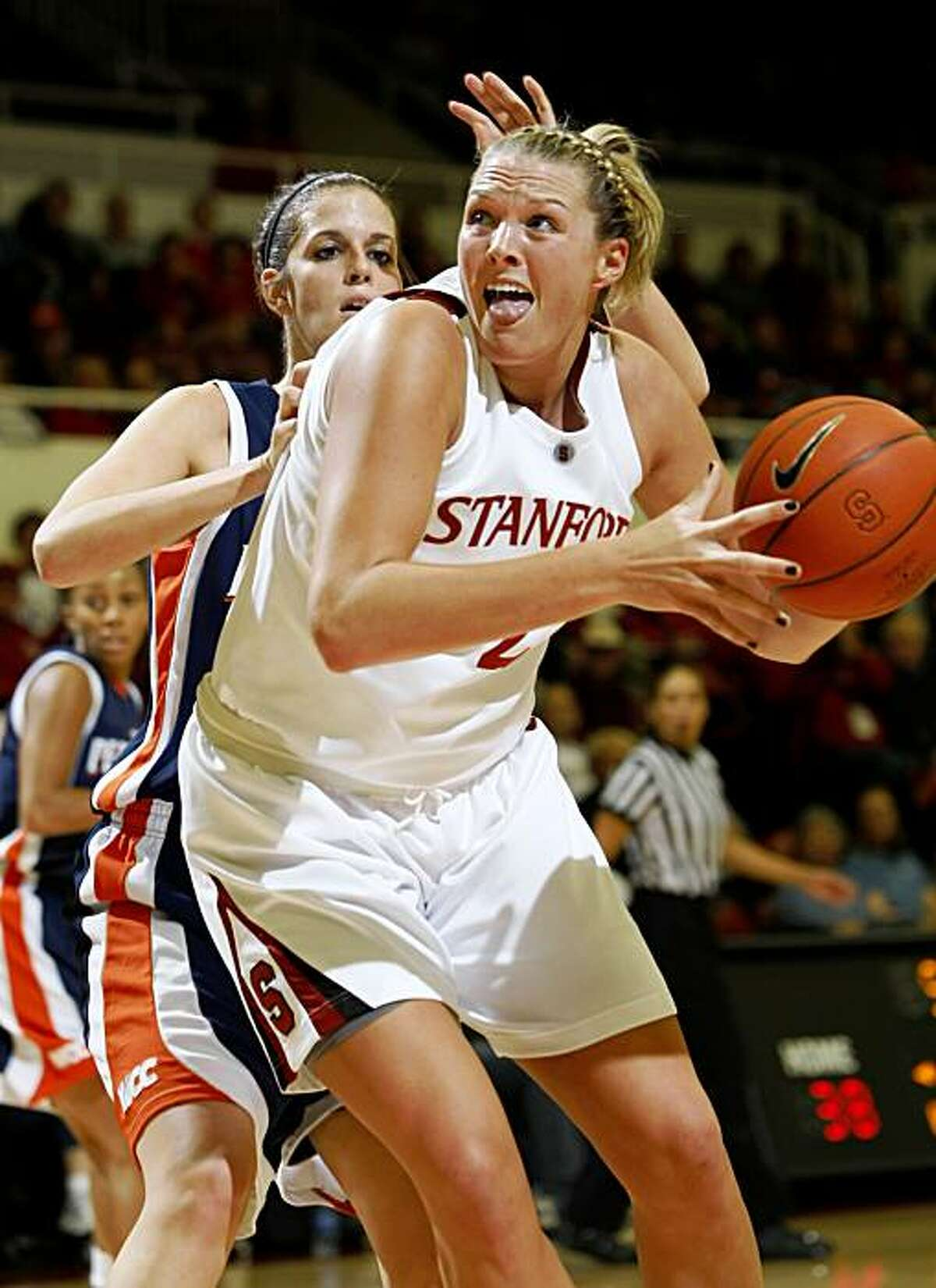 Stanford forward Jayne Appel (2) is closely covered by Pepperdine's Alex Jarrell (44) in the first half of an NCAA college basketball game in Stanford, Calif., Thursday, Nov. 19, 2009. (AP Photo/Paul Sakuma)