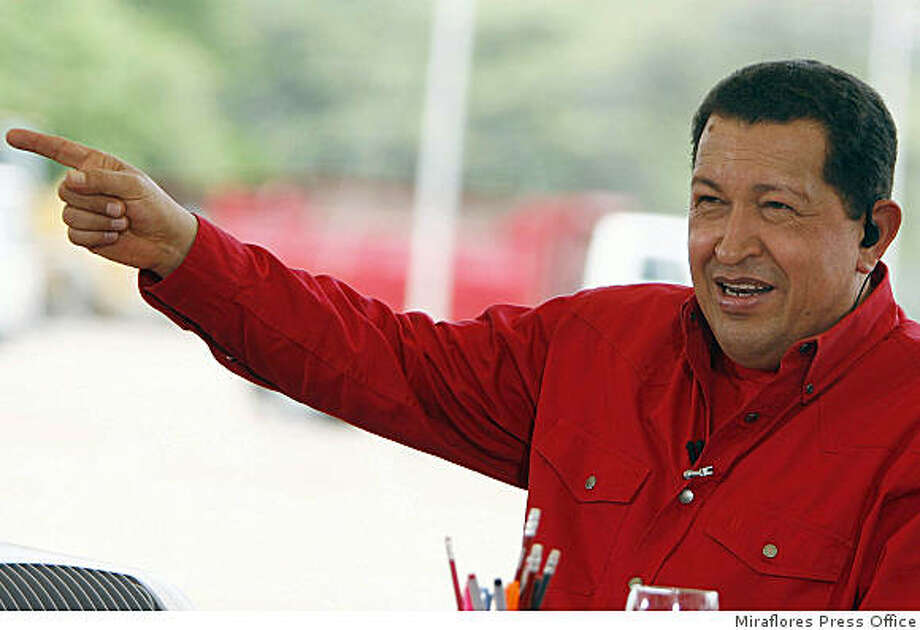 In this picture released by Miraflores Press Office, Venezuela's President Hugo Chavez speaks during his weekly television program in Santa Ana de Coro, Venezuela, Sunday, June 8, 2008.  Chavez urged rebels of the Revolutionary Armed Forces of Colombia, or FARC, to lay down their weapons, to unilaterally free dozens of hostages and to put an end to a decades-long armed struggle against Colombia's government. (AP Photo/Miraflores Press Office) **NO SALES** Photo: Miraflores Press Office, AP