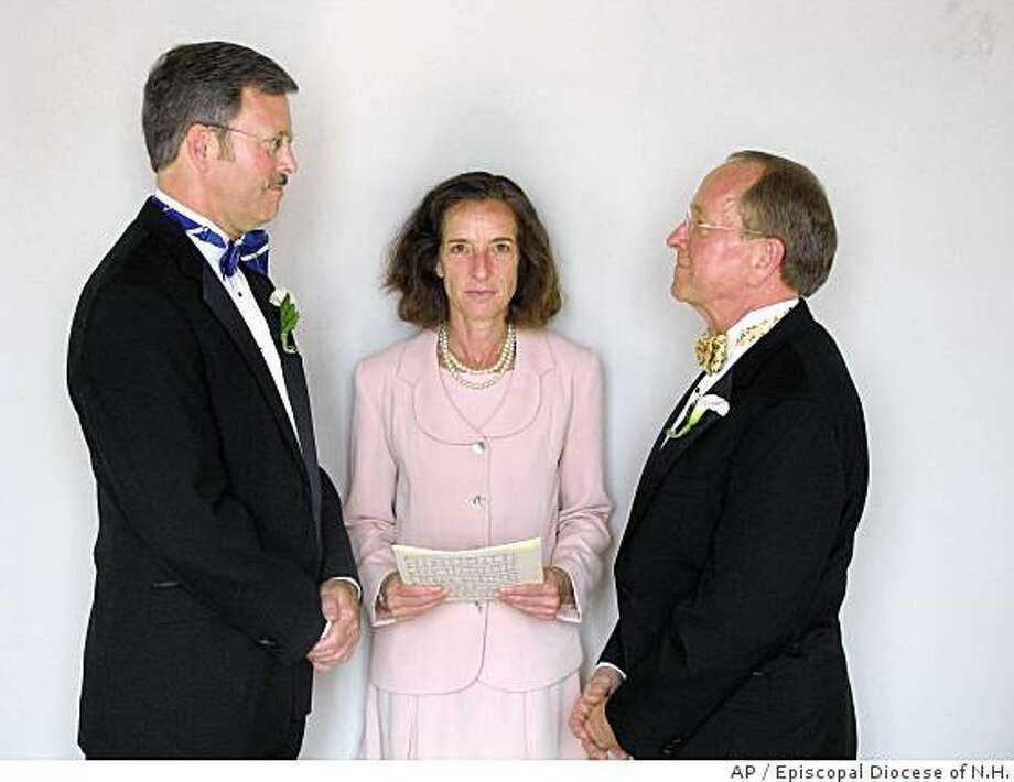 In this photo released by the Episcopal  Dioceses of New Hampshire, Mark Andrew, left, and Bishop V. Gene Robinson are shown during their private civil union ceremony performed by Ronna Wise in Concord, N.H., Saturday June 7, 2008. The New Hampshire legislature and governor made civil unions legal in New Hampshire beginning Jan. 1, 2008. (AP Photo/Episcopal  Dioceses of New Hampshire) Photo: Episcopal Diocese Of N.H., AP