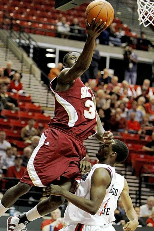 Santa Clara's Chris Cunningham drives over the top of San Diego State's Tyrone Shelley during the first half of their NCAA college basketball game Thursday Nov. 19, 2009 in San Diego. (AP Photo/Lenny Ignelzi) Photo: Lenny Ignelzi, AP