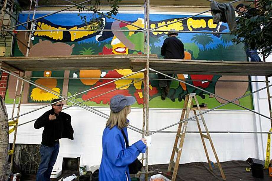 Artist Fredrick James  (top) is restoring a mural he did 30 years ago to what it was originally at Squat and Gobble in San Francisco, Calif., on Monday, November 16, 2009. Photo: Liz Hafalia, The Chronicle