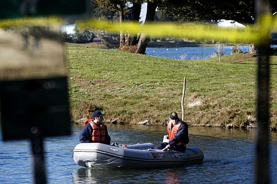 Alameda County Sheriff Volunteer Search and Rescue comb Aquatic Lagoon in Berkeley, Calif., for evidence after the body of a 23-year-old, Zoelina Williams, was found in the park. Photo: Adam Lau, The Chronicle