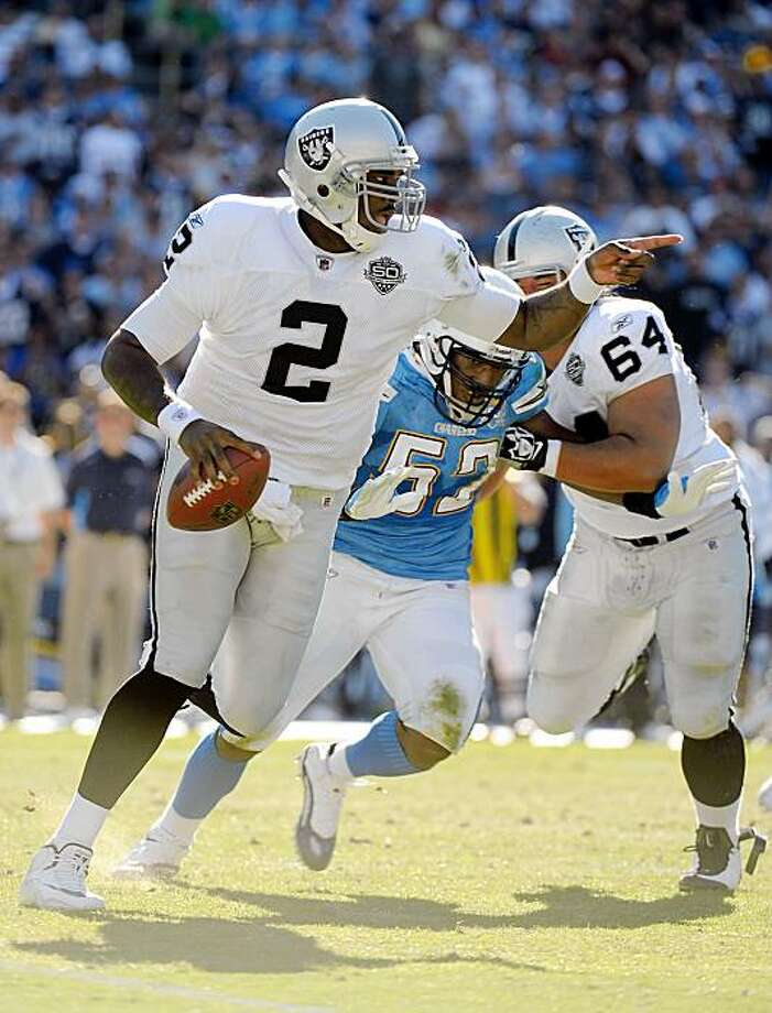 SAN DIEGO - NOVEMBER 01:  JaMarcus Russell #2 of the Oakland Raiders scrambles out of the pocket as he is rushed by Larry Engllish #52 of the San Diego Chargers during the second quarter at Qualcomm Stadium on November 1, 2009 in San Diego California.  (Photo by Harry How/Getty Images) Photo: Harry How, Getty Images