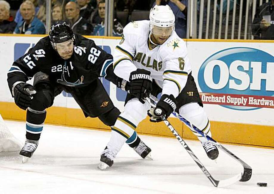 Dallas Stars' Trevor Daley, right, and San Jose Sharks' Dan Boyle (22) fight for the puck during the first period of an NHL hockey game Thursday, Nov. 12, 2009, in San Jose, Calif. (AP Photo/Ben Margot) Photo: Ben Margot, AP