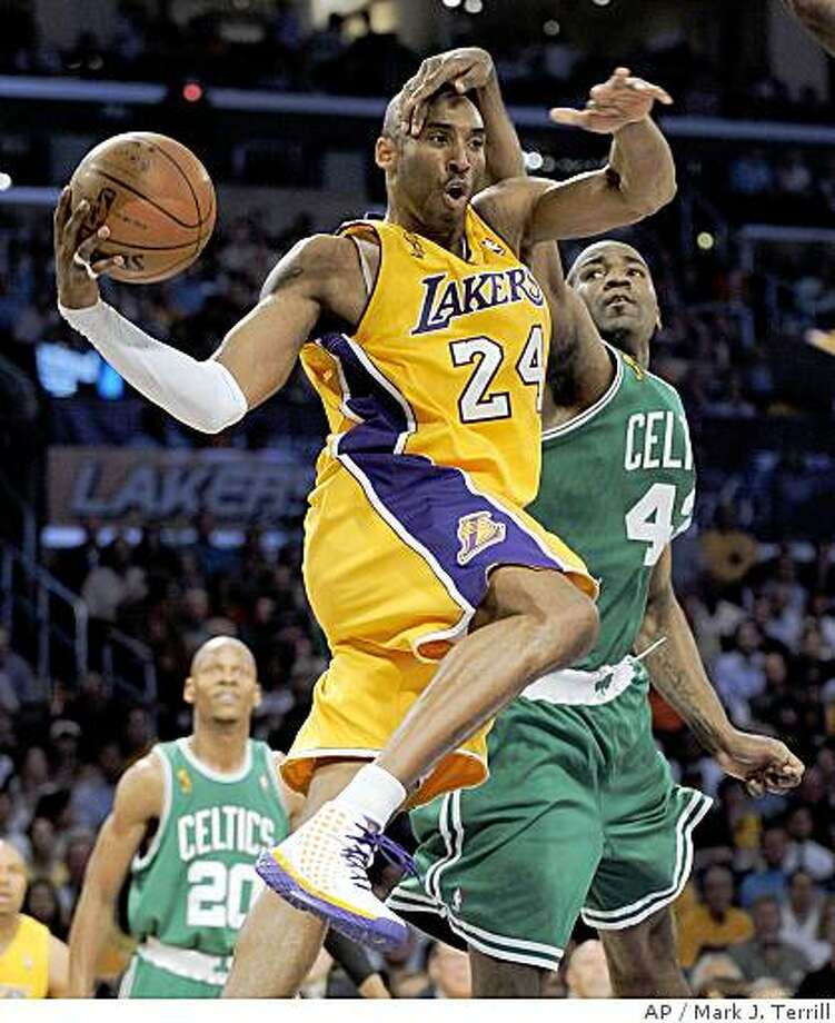 Los Angeles Lakers guard Kobe Bryant (24) tries to pass against the defense of Boston Celtics center Kendrick Perkins in the first half of Game 3 of the NBA basketball finals Tuesday, June 10, 2008, in Los Angeles. (AP Photo/Mark J. Terrill) Photo: Mark J. Terrill, AP