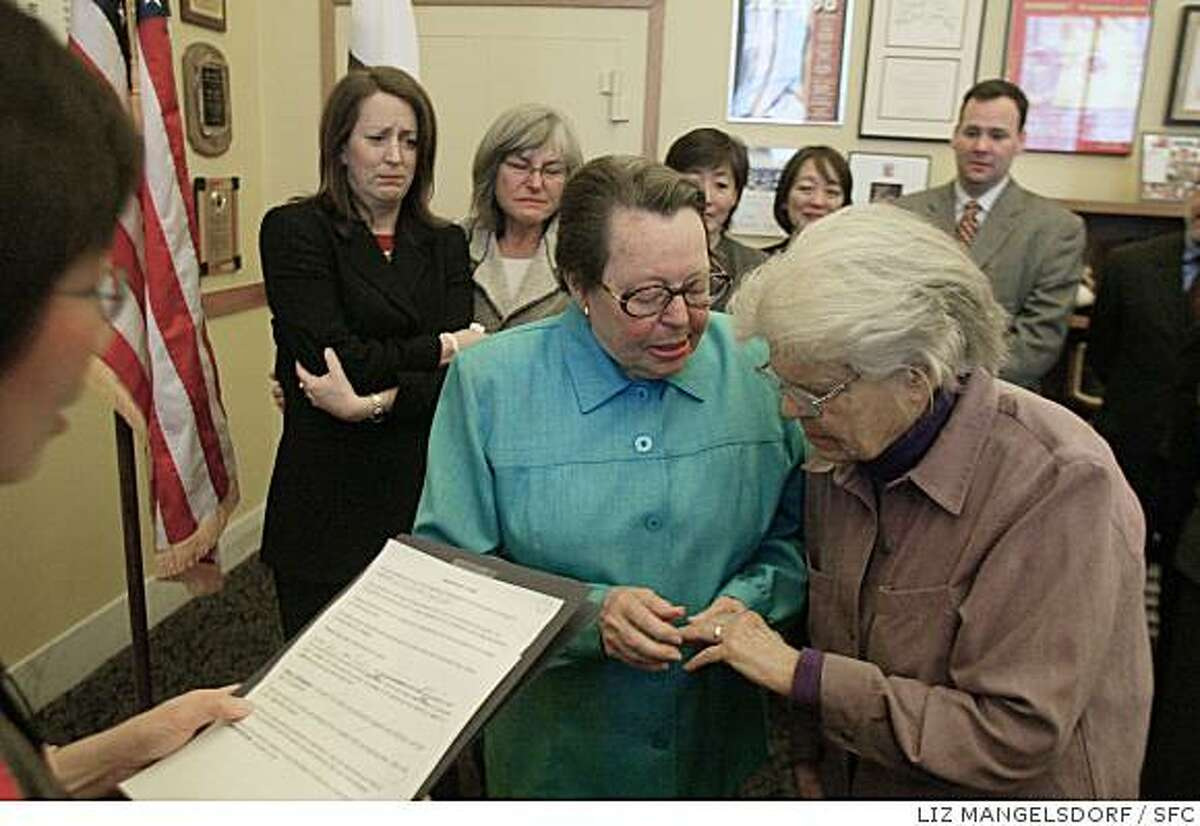 Phyllis Lyon, left, and Del Martin, who have been together for 51 years, exchange rings during their marriage ceremoney at City Hall in San Francisco, Thursday, Feb. 12, 2004. The longtime lesbian activists Lyon, 79, and Martin, 83, were the first to be married. In a political and legal challenge to California law, city authorities officiated at the marriages of several same-sex couples Thursday and issued dozens more marriage licenses to gay and lesbian couples. (San Francisco Chronicle, Liz Mangelsdorf)