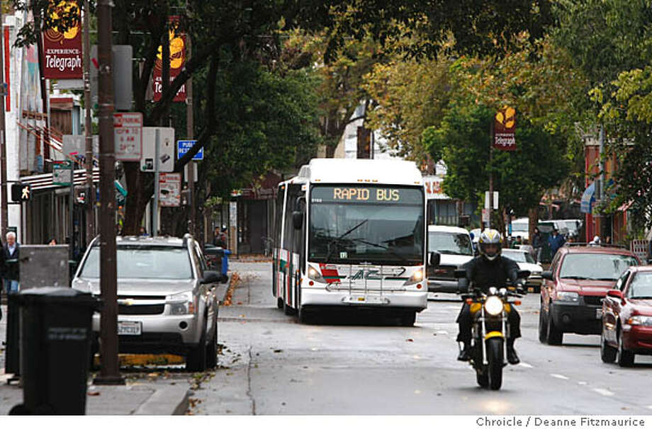 bus14_004_df.jpg  This is a Rapid Transit bus along Telegraph Ave near campus. AC Transit plans to put a high speed bus route from San Leandro to Berkeley. Photographed in Berkeley on 10/12/07. Deanne Fitzmaurice / The Chronicle Ran on: 10-14-2007  An AC Transit bus rolls along a street near the University of California campus, where planners envision a transit village as part of a bus rapid transit line linking Berkeley and San Leandro. Photo: Deanne Fitzmaurice