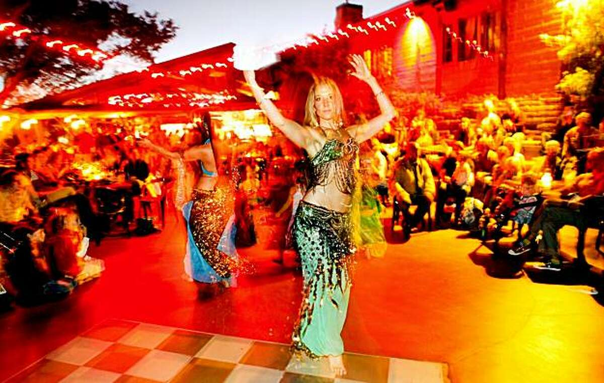 BIG SUR, CA---Holly Christina Rose bellydances at a launch party for