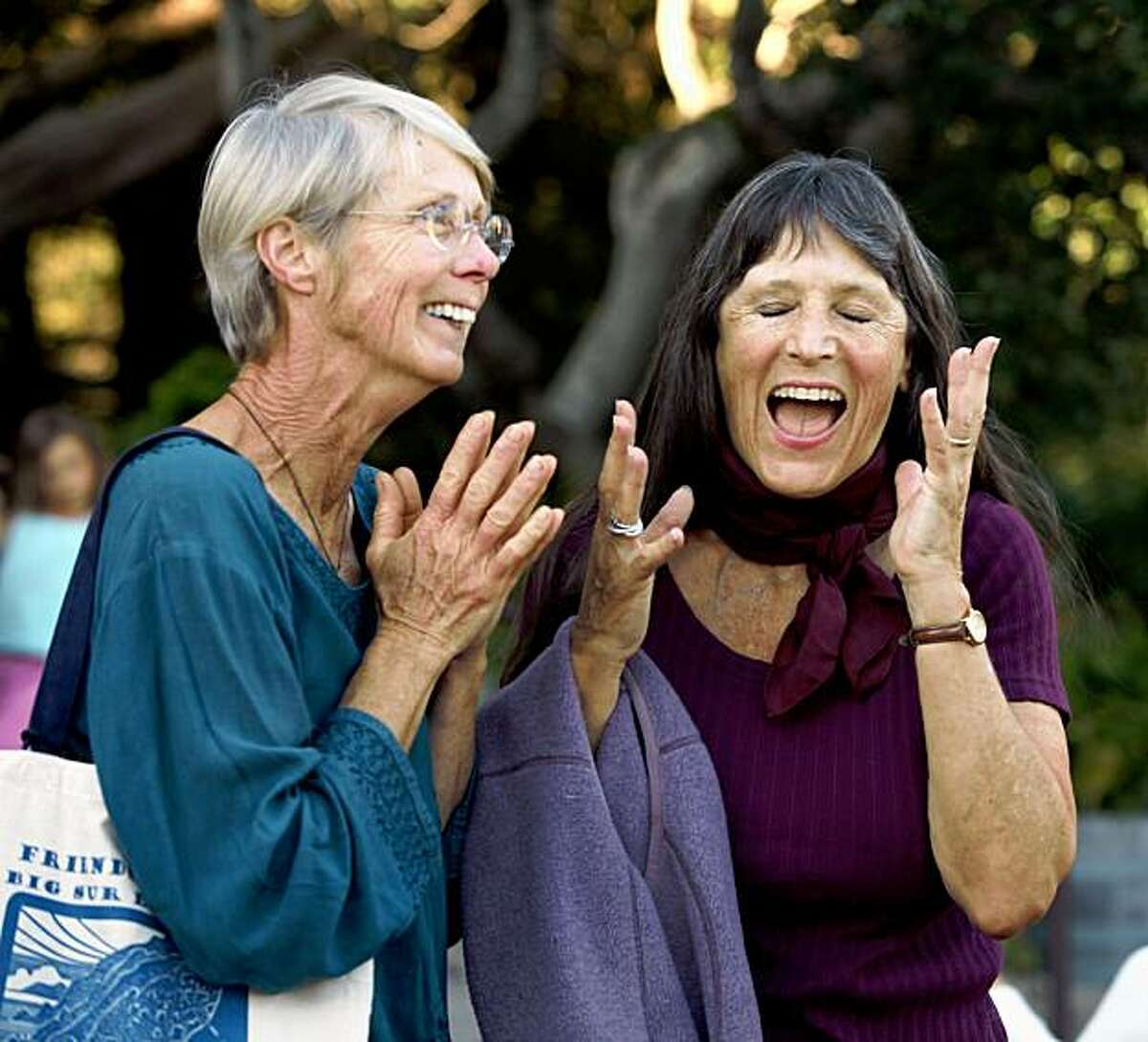 BIG SUR, CA---Barbara Woyt, lf, and Holly Fassett, owner of Nepenthe share a laugh at the launch party for