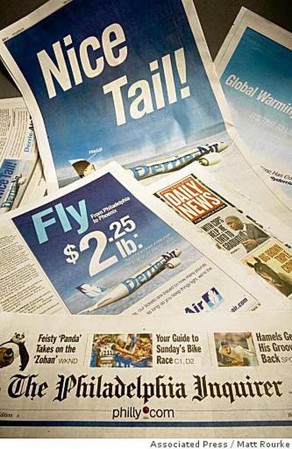 "This display shows advertisements for a fictitious airline that appeared in a one-day advertising campaign by Philadelphia Media Holdings in the Philadelphia Inquirer and Philadelphia Daily News, in Philadelphia, Friday, June 6, 2008. Company spokesman Jay Devine said the goal is to ""demonstrate the power of our brands in generating awareness and generating traffic for our advertisers, and put a smile on people's faces."" (AP Photo/Matt Rourke) Photo: Matt Rourke, Associated Press"