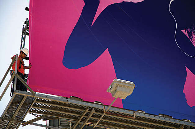 Chad Tiedeman, erecting billboard for iPod during the filming of ART & COPY. Photo: Michael Nadeau