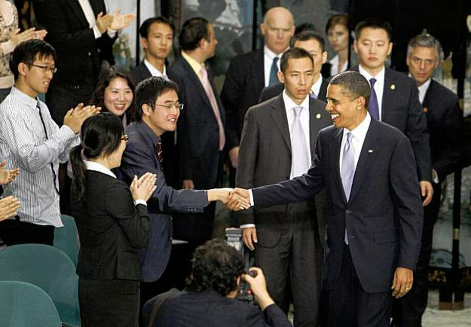 U.S. President Barack Obama arrives at a town hall style event with Chinese youth at the Museum of Science and Technology in Shanghai, China,  Monday, Nov. 16, 2009. (AP Photo/Charles Dharapak) Photo: Charles Dharapak, AP