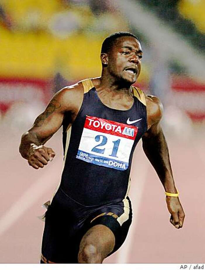 ** FILE ** Justin Gatlin of the United States competes in the Men's 100-meter event at the Qatar Grand Prix in Doha, Qatar Friday May 12, 2006.Gatlin equaled but did not break the 100-meter world record at the Qatar Grand Prix last week, the sport's governing body said Wednesday May 17, 2006.The International Association of Athletics Federations said a timing error in Doha gave Gatlin a time of 9.76 seconds, which was one-hundredth of a second below Asafa Powell's world mark of 9.77. (AP Photo/STR)Ran on: 05-19-2006Justin Gatlin held the 100-meter record for five days this month before it was overturned.Ran on: 05-19-2006 ** FILE ** Justin Gatlin of the United States competes in the Men's 100-meter event at the Qatar Grand Prix in Doha, Qatar Friday May 12, 2006.Gatlin equaled but did not break the 100-meter world record at the Qatar Grand Prix last week, the sport's governing body said Wednesday May 17, 2006.The International Association of Athletics Federations said a timing error in Doha gave Gatlin a time of 9.76 seconds, which was one-hundredth of a second below Asafa Powell's world mark of 9.77. (AP Photo/STR) Ran on: 05-19-2006 Justin Gatlin held the 100-meter record for five days this month before it was overturned. Photo: Afad, AP