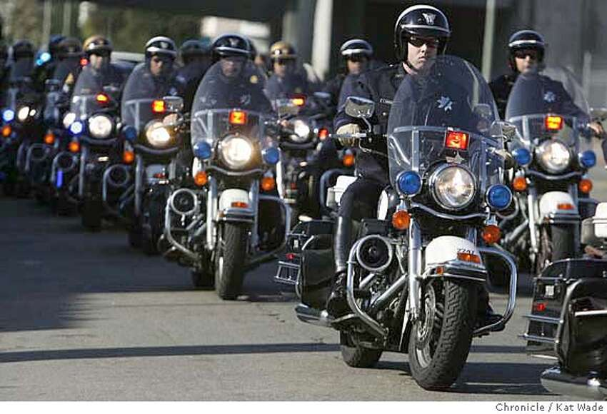 CHP_065_KW_.jpg Oakland motorcycle police fall in behind the California Highway Patrol officers as hundreds of law enforcement officers in front of Oaklands California Highway Patrol office on Telegraph in Oakland Thursday August 10, 2006 as they begin the funeral possesion for CHP Officer Brett Clearman (PLEASE CHECK SPELLING OF CLEARMAN'S NAME) who was the victim of a hit-and-run. Kat Wade/The Chronicle ** (Subject) cq Mandatory Credit for San Francisco Chronicle and photographer, Kat Wade, Mags out