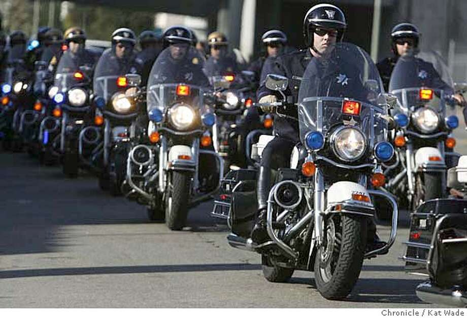 CHP_065_KW_.jpg  Oakland motorcycle police fall in behind the California Highway Patrol officers as hundreds of law enforcement officers in front of Oaklands California Highway Patrol office on Telegraph in Oakland Thursday August 10, 2006 as they begin the funeral possesion for CHP Officer Brett Clearman (PLEASE CHECK SPELLING OF CLEARMAN'S NAME) who was the victim of a hit-and-run.  Kat Wade/The Chronicle ** (Subject) cq Mandatory Credit for San Francisco Chronicle and photographer, Kat Wade, Mags out Photo: Kat Wade