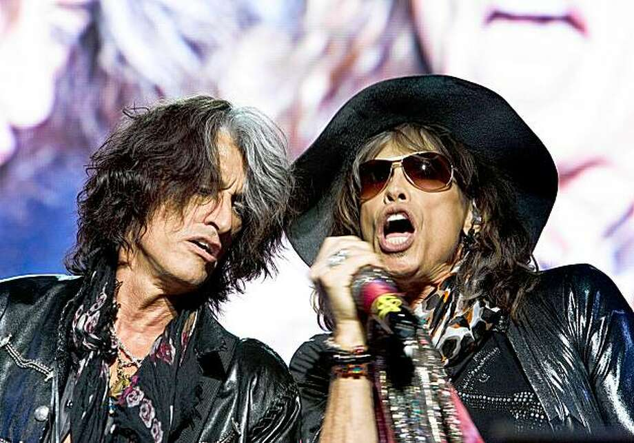 A handout picture released by Flash Entertainment shows US rock band Aerosmith's frontman Steven Tyler (R) and guitarist Joe Perry performing at the end of the Abu Dhabi Grand Prix in the Gulf emirate late on November 1, 2009. AFP PHOTO/HO == RESTRICTED TO EDITORIAL USE == (Photo credit should read -/AFP/Getty Images) Photo: -, AFP/Getty Images