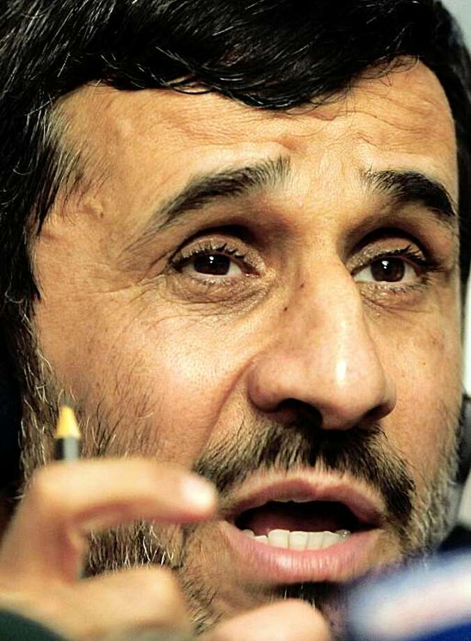"Iranian President Mahmoud Ahmadinejad speaks during a news conference after 25th Meeting of the Standing Committee for Economic and Commercial Cooperation (COMCEC) of the Organization of the Islamic Conference in Istanbul on November 9, 2009. Ahmadinejad told the West that dialogue and cooperation were the only way to resolve the dispute over his country's nuclear push which he said was a ""natural right"". AFP PHOTO/BULENT KILIC (Photo credit should read BULENT KILIC/AFP/Getty Images) Photo: Bulent Kilic, AFP/Getty Images"