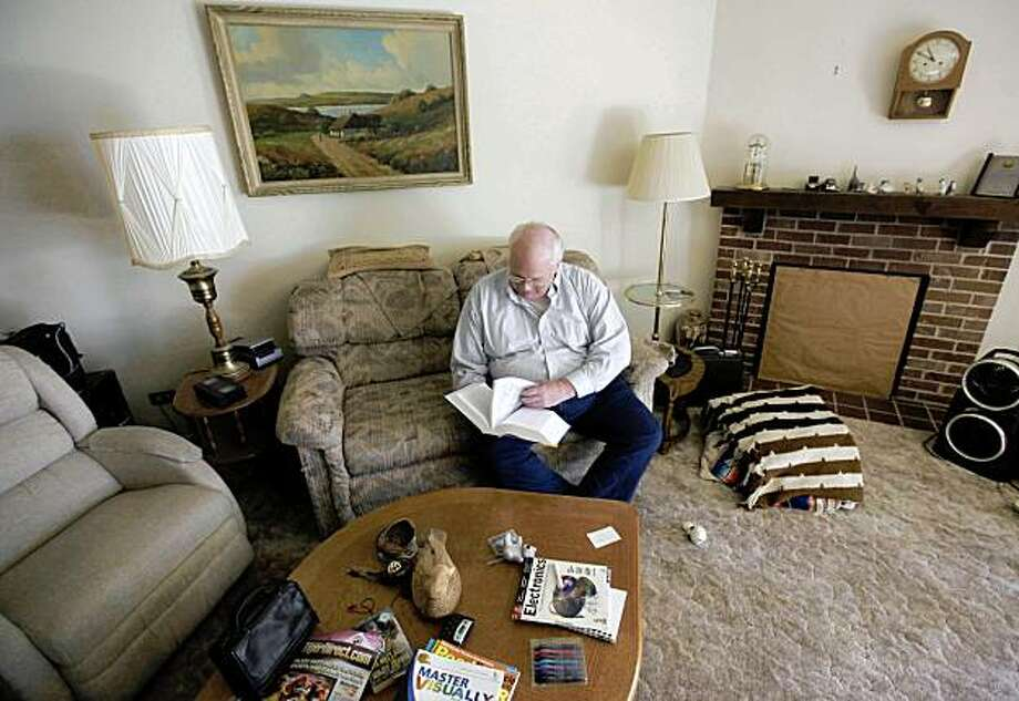In this photo taken Monday, Oct. 19, 2009, Donald Schenk brushes up on his skills in his apartment in Schaumburg, Ill. Schenk has been out of work for over a year. (AP Photo/M. Spencer Green) Photo: M. Spencer Green, AP