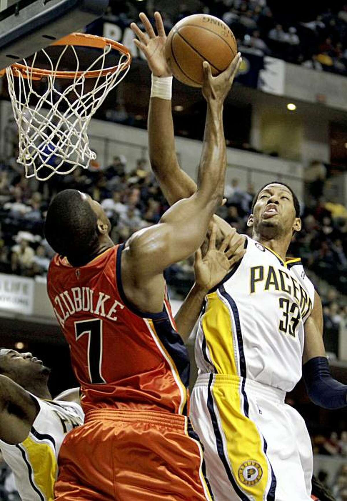 Indiana Pacers forward Danny Granger, right, blocks the shot of Golden State Warriors forward Kelenna Azubuike during the second half of an NBA basketball game in Indianapolis, Wednesday, Nov. 11, 2009. The Pacers won 108-94. (AP Photo/AJ Mast)