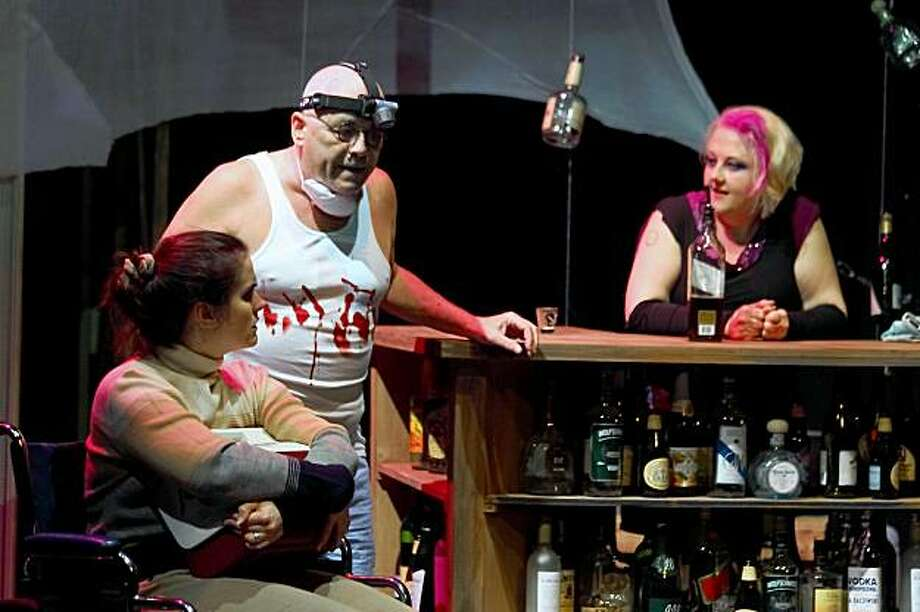 "From left: Lydia (Megan Kilian), Ulrich (Dennis McIntyre) and Dinah (Tracey Rhys) discuss the transplant of Harry's brain in ""The Afterlife of the Mind"" at Stage Werx in San Francisco. Photo: Luis A. Solorzano"