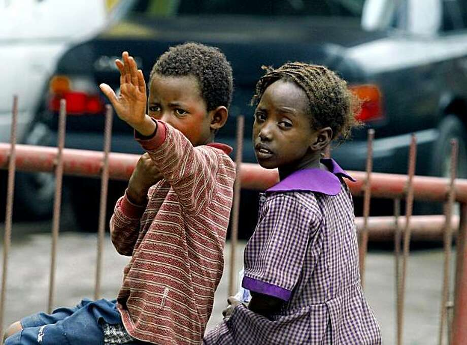 FILE - In this Friday, June 3, 2005 file photo, two unidentified homeless children beg for food and money in a street of Lagos, Nigeria. Nearly 200 million children in poor countries have stunted growth because of insufficient nutrition, according to a new report published by UNICEF Wednesday before a three-day international summit on the problem of world hunger. The head of a U.N. food agency called on the world to join him in a day of fasting ahead of the summit to highlight the plight of 1 billion hungry people. (AP Photo/George Osodi, File) Photo: George Osodi, File, AP