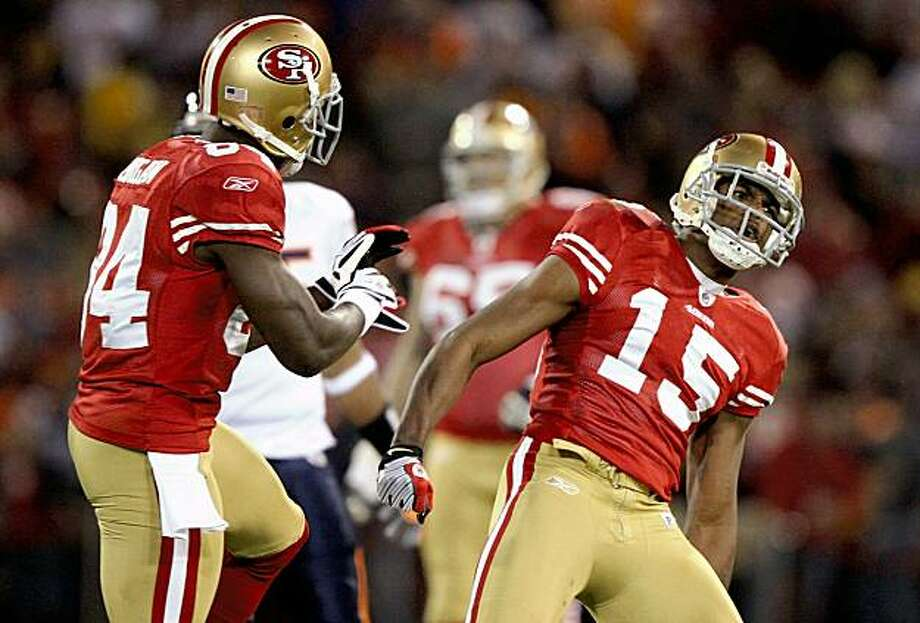 SAN FRANCISCO - NOVEMBER 12:  Michael Crabtree #15 and Josh Morgan #84 of the San Francisco 49ers celebrate after Crabtree made a recetprion against the Chicago Bears at Candlestick Park on November 12, 2009 in San Francisco, California.  (Photo by Jed Jacobsohn/Getty Images) Photo: Jed Jacobsohn, Getty Images