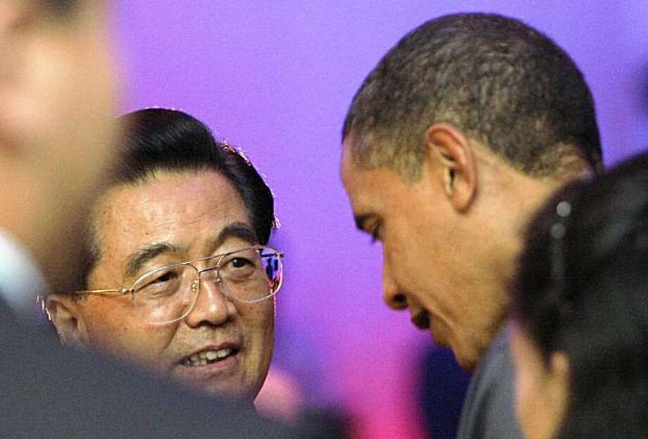 U.S. President Barack Obama right, talks with China's President Hu Jintao during the Gala Dinner at the APEC Summit in Singapore, Saturday, Nov.14, 2009.(AP Photo/) Photo: Stringer, AP