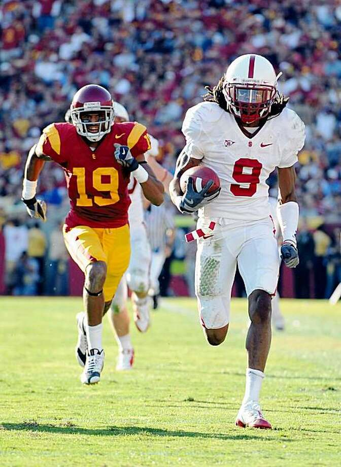 Richard Sherman #9 of the Stanford Cardinal scores a touchdown off his interception as he is chased by Drew McAllister #19 of the USC Trojans during the second half at the Los Angeles Memorial Coliseum on November 14, 2009 in Los Angeles, California. Photo: Harry How, Getty Images