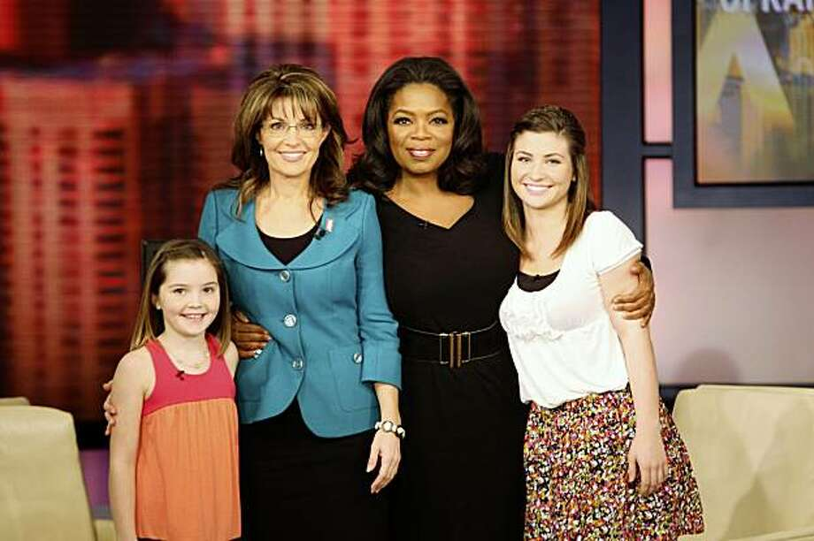 "In this photo taken Wednesday, Nov. 11, 2009 and released Friday, Nov. 13, 2009  by Harpo Productions, Inc., seen is talk-show host Oprah Winfrey, second from right, with former Republican vice presidential candidate Sarah Palin and her daughters, Willow, right, and Piper, left, during the taping of ""The Oprah Winfrey Show"" in Chicago. The show will air on Monday, Nov. 16. (AP Photo/Harpo Productions, Inc., George Burns)    ** MANDATORY  CREDIT: Harpo Productions, George Burns. NO SALES ** Photo: George Burns, AP"