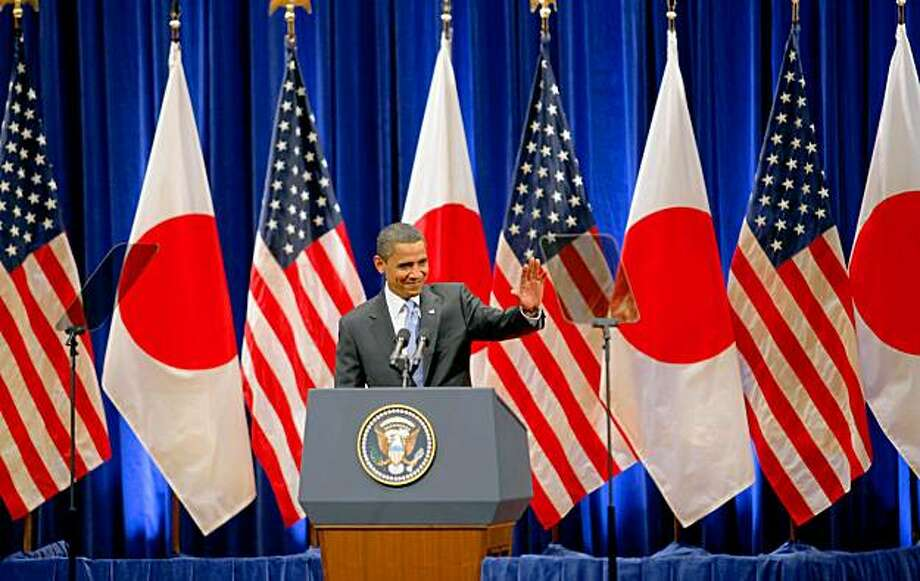 U.S. President Barack Obama arrives at a hall to deliver speech in Tokyo Saturday, Nov. 14, 2009. Obama said in the speech that he welcomes a robust China on the world scene, but he cautioned that all nations must respect human rights, including religious freedoms. (AP Photo/Itsuo Inouye) Photo: Itsuo Inouye, AP