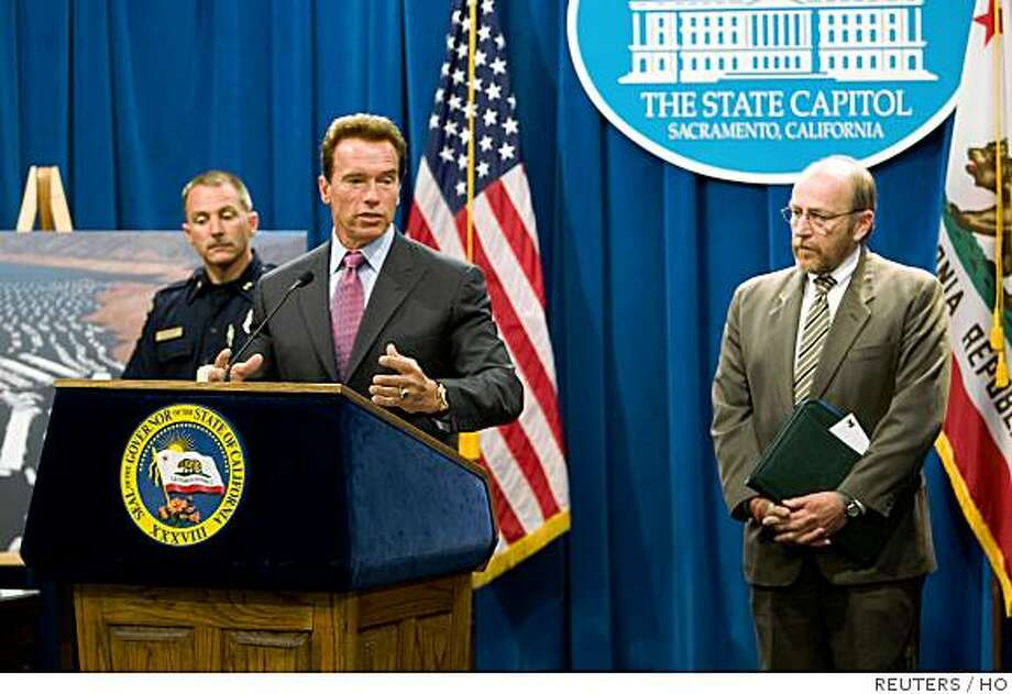 California Governor Arnold Schwarzenegger speaks at a news conference in Sacramento, California in this handout picture released by his office June 4, 2008. After two years of below-average rainfall in California, Schwarzenegger declared a statewide drought on Wednesday, and issued an executive order, which allows water officials to more rapidly shift water around California, one of the nation's top farm states that also has wilderness areas prone to wildfires. Shown with Schwarzenegger are CalFIRE Assistant Deputy Director Ken Pimlott (L) and  Department of Water Resources Director Lester Snow. REUTERS/William Foster/Office of Governor Schwarzenegger/Handout (UNITED STATES) Photo: HO, REUTERS