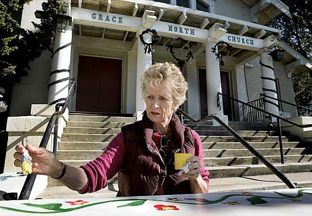Katharine Osburn paints a casket on the front steps of the Funeral Fair at the Grace North Church in Berkeley California on Saturday Nov. 7th. Photo: John Storey, Special To The Chronicle