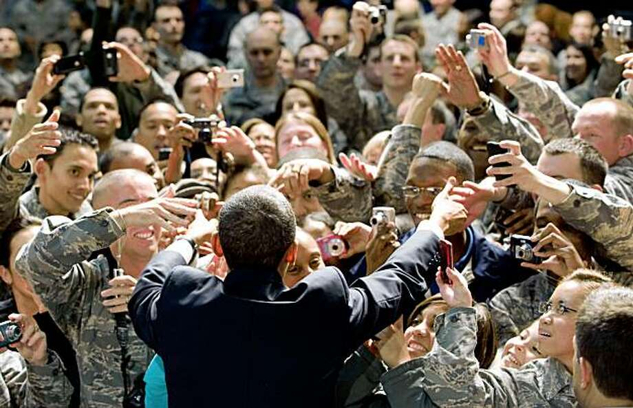 US President Barack Obama greets guests during a rally with US troops and their families at Elmendorf Air Force Base in Anchorage, Alaska, November 12, 2009. The stopover marks Obama's first ever visit to Alaska, the first stop on an 8-day trip to Japan, Singapore, China and South Korea. AFP PHOTO / Saul LOEB (Photo credit should read SAUL LOEB/AFP/Getty Images) Photo: Saul Loeb, AFP/Getty Images