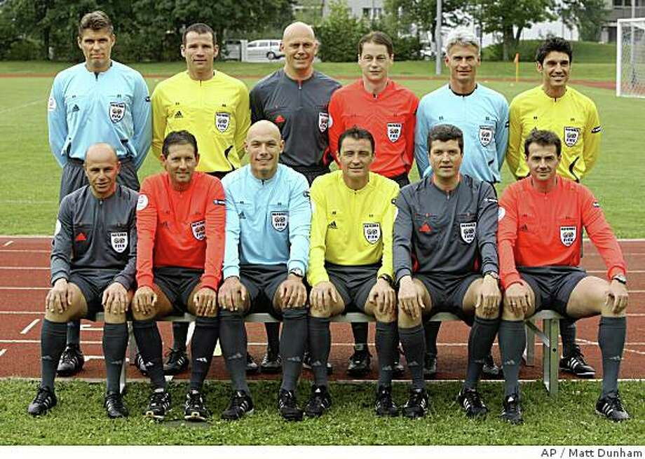 The twelve referees for Euro 2008 pose for a group photograph before a referee's training session at playing facilities in Regensdorf, Switzerland, Thursday, June 5, 2008.  Italy's Roberto Rosetti will referee the opening game of the Euro 2008 European Soccer Championships in Austria and Switzerland between Switzerland and Czech Republic.  Pictured are, top row from left,  Italy's Roberto Rosetti, Holland's Pieter Vink,  Norway's Tom Henning Ovrebo, Slovakia's Lubos Michel, Sweden's Peter Frojdfeldt, Switzerland's Massimo Busacca, bottom row from left, Austria's Konrad Plautz, Belgium's Frank De Bleeckere, England's Howard Webb, Spain's Manuel Enrique Mejuto Gonzalez, Germany's Herbert Fandel and Greece's Kyros Vassaras.  (AP Photo/Matt Dunham) Photo: Matt Dunham, AP