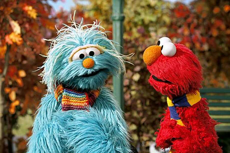 "This photo released by the Sesame Workshop shows Rosita, left, and Elmo in a scene from""TLC II Military Outreach Project"", directed by Kevin Clash. Mention swine flu to a young child, and odds are pretty good you'll get a blank stare. But an increasing number of kids can tell you that the Sesame Street character ""Elmo"" sneezes properly into the crook of his arm, and if they sing the whole ""ABCs"" song while washing their hands they'll get them really clean. (AP Photo/Sesame Workshop, Richard Termine)**NO SALES** Photo: Richard Termine, AP"