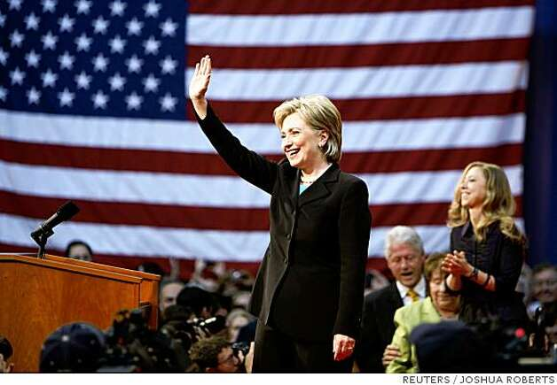 US Democratic presidential candidate Senator Hillary Clinton (D-NY) waves as she arrives with her daughter, Chelsea (R) and husband, former President Bill Clinton at the National Building Museum in Washington, June 7, 2008. Hillary Clinton plans to host a rally for supporters on Saturday where she will formally drop out of the contest and throw her support behind her rival of the last 16 months, presumptive Democratic presidential nominee Senator Barack Obama (D-IL).    REUTERS/Joshua Roberts   (UNITED STATES)   US PRESIDENTIAL ELECTION CAMPAIGN 2008 Photo: JOSHUA ROBERTS, REUTERS