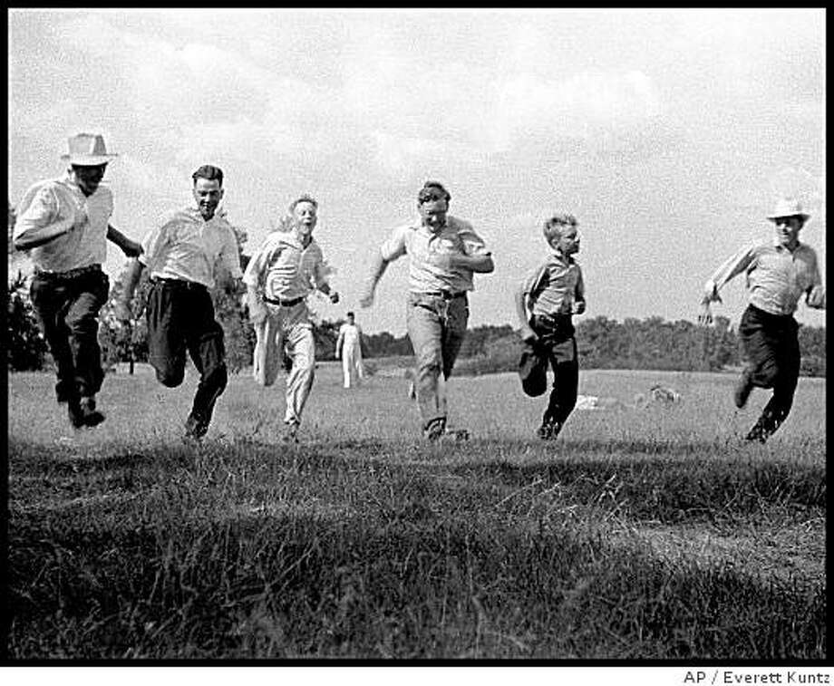 "**CORRECTS YEAR DIED TO 2003** **APN ADVANCE FOR SUNDAY JUNE 8** This photo, supplied by the University of Iowa Press, entitled ""Men's Race"" taken between 1939 and 1942 in Ridgeway, Iowa, and was included in a book being published by the University of Iowa Press. Kuntz died in 2003.(AP Photo/University of Iowa Press, Everett Kuntz) Photo: Everett Kuntz, AP"