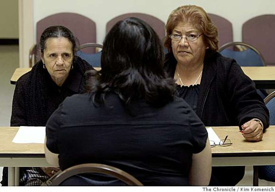 Josefina Martinez, 70, left, and Maria Carrillo, 67, both of Oakland, meet with independent living specialist Leticia Escalera, back to camera, at the Spanish Speaking Citizens Foundation in Oakland, Calif. The women are among the center's clients who are signing petitions urging California Gov. Arnold Schwarzenegger not to cut California's Cash Assistance Program for Immigrants, a $111million- dollar basic assistance program for legal immigrants who are old, blind or disabled. The program helps 10,300 people a month. Legal analysts say the proposed cuts would affect people who can least stand an impact. Photo: Kim Komenich, The Chronicle