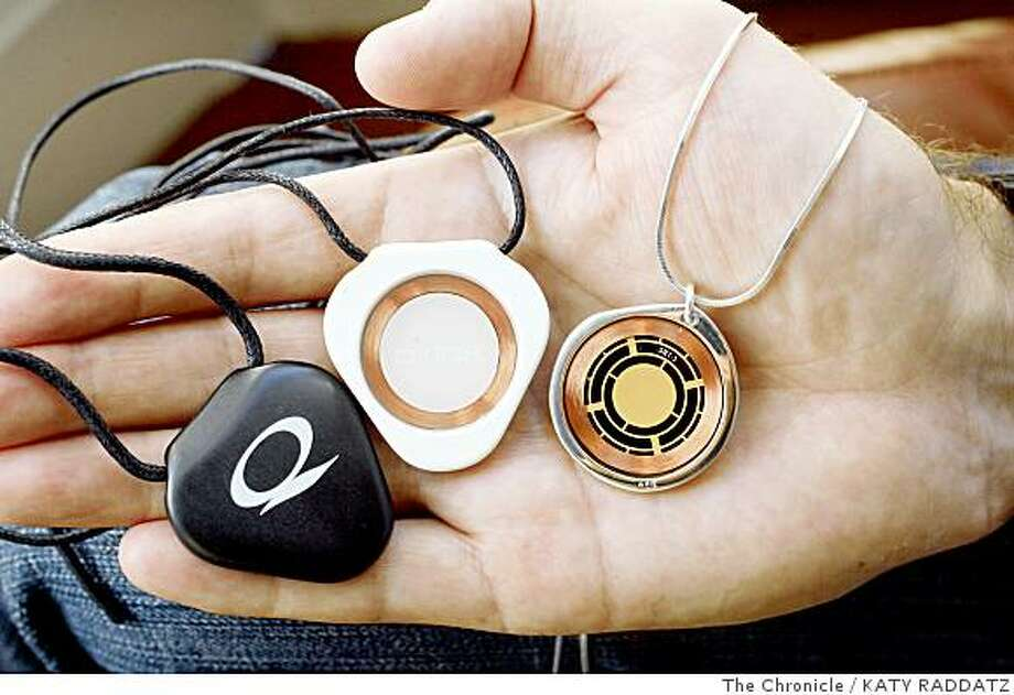 Richard Gray, holding the Q-Link Black pendant, left, the Q-Link White pendant, center, and the Q-link Silver Pebble pendant, right, in his hand,  is the President and CEO of Clarus Transphase Scientific, Inc., makers of Q-Link pendants and bracelets, which boast the most advanced personal energy system avail, which is powered by Sympathetic Resonance Technology, in San Francisco,  Calif.  on Wednesday June 4, 2008.Photo by Katy Raddatz / The Chronicle Photo: KATY RADDATZ, The Chronicle
