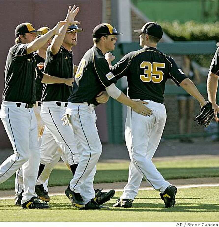Wichita State's Anthony Capra (35) celebrates with his teammates after closing out Florida State in the ninth inning of the Tallahassee Super Regional baseball game on Friday, June 6, 2008, in Tallahassee, Fla. Wichita State won 10-7. (AP Photo/Steve Cannon) Photo: Steve Cannon, AP